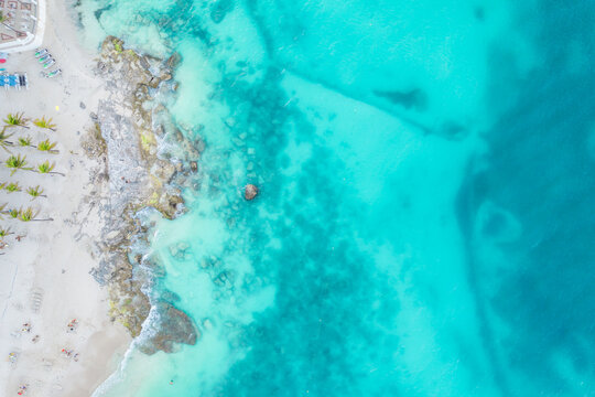 Aerial view of sandy beach and ocean with small waves in Cancun, Mexico. Top view from drone. Playa Caracol of Riviera Maya in Quintana roo region on the Yucatan Peninsula