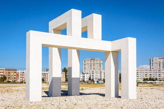 Le Havre, France - June 7, 2021: UP#3 is a monumental sculpture in white concrete by Sabina Lang and Daniel Baumann installed permanently on the beach in Le Havre since July 2018.