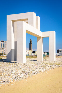 Le Havre, France - June 7, 2021: The lantern tower of St. Joseph's church seen through the monumental sculpture UP#3 by Sabina Lang and Daniel Baumann, installed on the beach since July 2018.