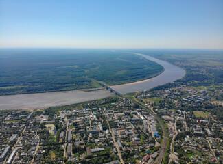 Aerial view of the city, Vyatka river and railway bridge (Kotelnich, Kirov region, Russia)
