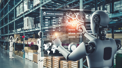 Fototapeta Innovative industry robot working in warehouse for human labor replacement . Concept of artificial intelligence for industrial revolution and automation manufacturing process . obraz