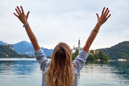 Woman with arms outstretched enjoying in the nature.