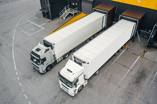 Two trucks loading in the distribution hub