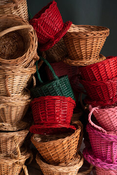 Piles of colorful wicker baskets