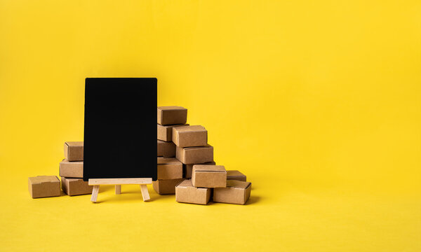 Online shopping with blank label and product box on yellow background.