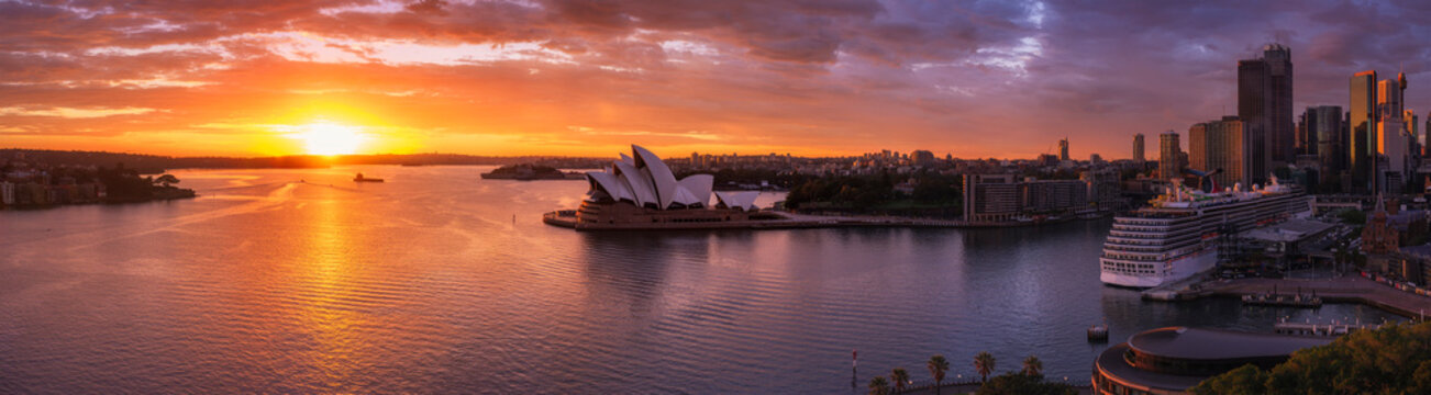 Sydney harbour with cruise ship docked at dawn.