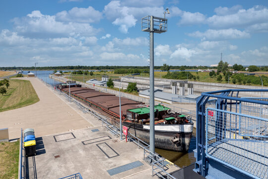 German sluice near Magdeburg with cargo ship in lock chamber