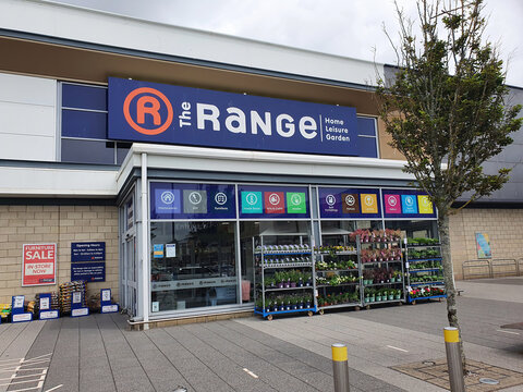 Llanelli, Wales, UK, July6, 2021 : The Range advertising logo sign outside the entrance to one of their business retail stores outside the city centre, stock photo image