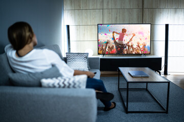 Woman Watching TV Movie. Enjoying Cinema