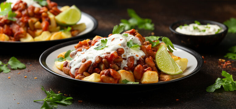 Spicy Bean Chilli with Baked Potato, sour cream and lime. Healthy Food