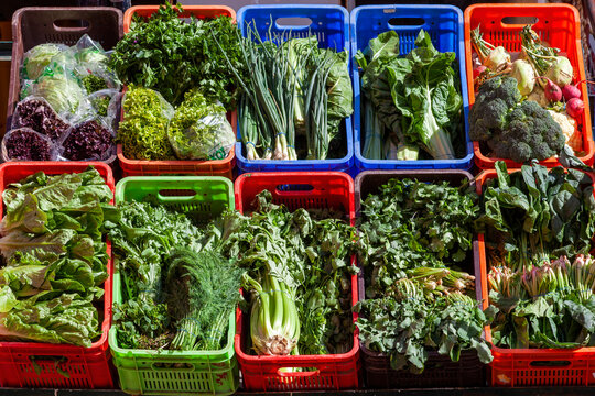 Fresh vegetable and salad which have nutrition health benefits on display outside a greengrocers shop, stock photo image