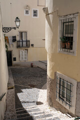 View of one of the narrow streets of the Alfama district, Lisbon.