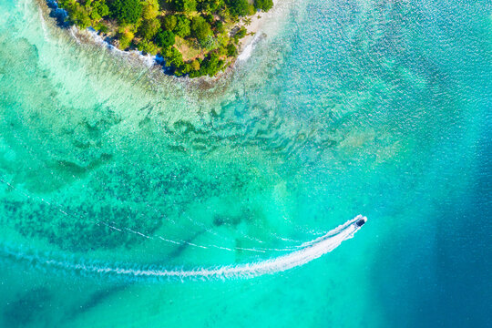 Aerial drone view of beautiful caribbean tropical island Cayo Levantado beach with palms and boat. Bacardi Island, Samana, Dominican Republic. Vacation background.