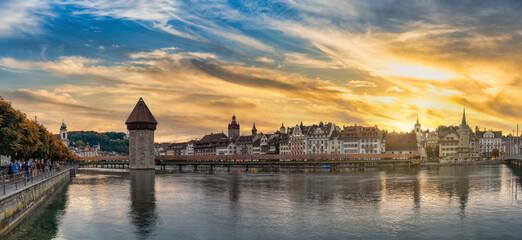 Lucerne (Luzern) Switzerland, panorama sunset city skyline at Chapel Bridge with autumn foliage...