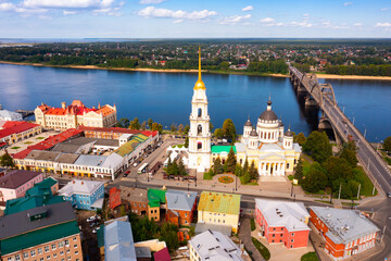 Aerial panoramic view of Rybinsk cityscape overlooking automobile bridge across Volga river and...