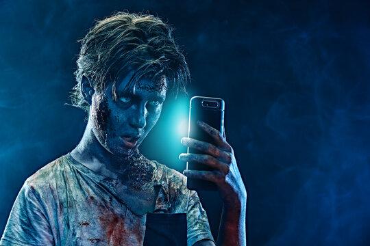 teen zombie with smartphone
