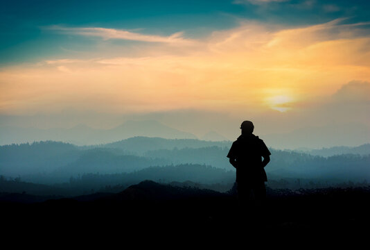 silhouette of a person in the mountains