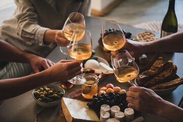 Fototapeta Friends having wine tasting or celebrating event with wine obraz