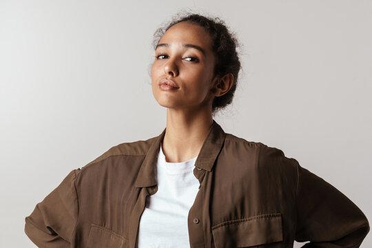 Young hispanic woman posing and looking at camera