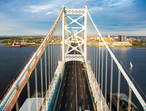 Aerial view of Ben Franklin Bridge and Camden, NJ on a sunny afternnon. Ben Franklin Bridge is a suspension bridge connecting Philadelphia and Camden, NJ.