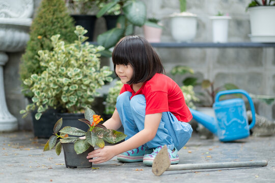 Children planting trees with nature background, happy asian girl
