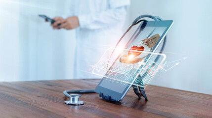 Fototapeta Medical examination and healthcare business via virtual interface technology.Doctor with stethoscope check and analysing patient heart health and increasing growth graph medical business on tablet. obraz