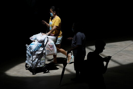 Woman pushes her grocery cart during the coronavirus disease outbreak, in Singapore