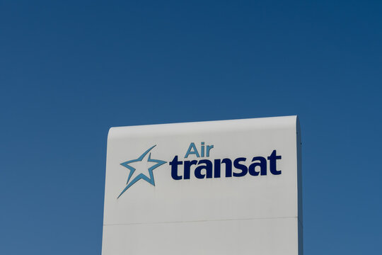 Montreal, QC, Canada - September 4, 2021: Air Transat sign with blue sky in background in Montreal, QC, Canada. Air Transat is a Canadian airline owned and operated by Transat A.T. Inc.