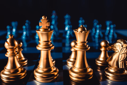 Board game chess. Figures of gold color on a blue background close-up.