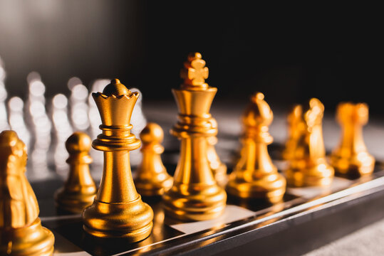 Board game chess. Figures of gold color close-up.