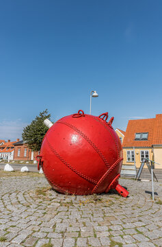 a red buoy lying on the square