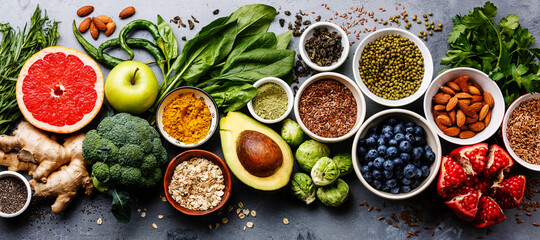 Fototapeta Healthy food clean eating selection: fruit, vegetable, seeds, superfood, cereal, leaf vegetable on gray concrete background obraz