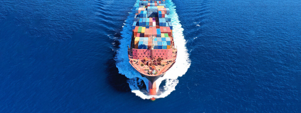 Aerial drone panoramic ultra wide photo of view of ship's bow from industrial container tanker cruising in open ocean deep blue sea