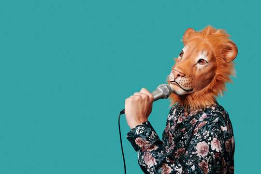 man wearing a lion mask speaks into a microphone