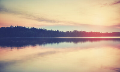 Fototapeta Lake at sunset, color toning applied. obraz