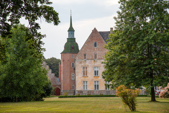 Mansion house and church of Holsteinborg Castle, beuatifully situated among the trees in the big gar