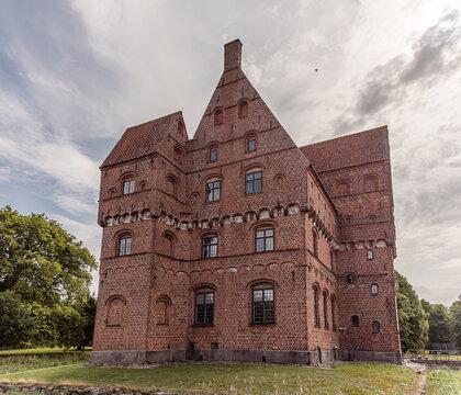 the famous fairytale castle Borreby is a tall brick-building