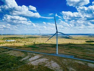 Fototapeta Wind turbines at the countryside in summer day, aerial view obraz