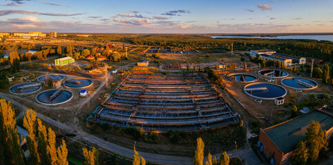 Fototapeta Modern wastewater treatment plant, aerial view from drone at the evening sunset obraz