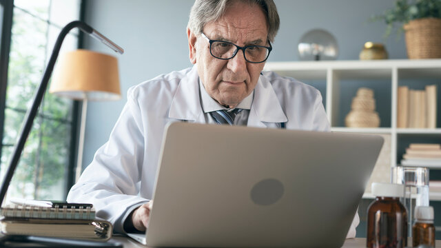 Doctor using laptop computer in the medical clinic