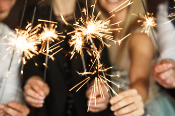 Fototapeta Out of focused image of people with sparklers celebrating  holiday or event obraz