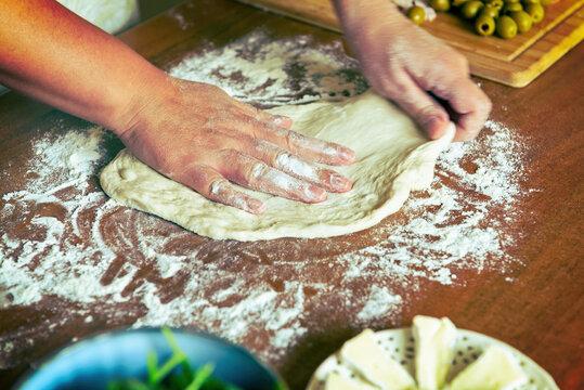 Preparing the Italian pizza