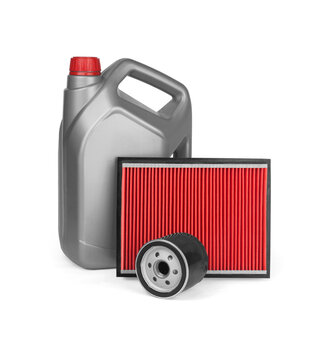 Canister with machine oil, air filter and oil filter isolated on white