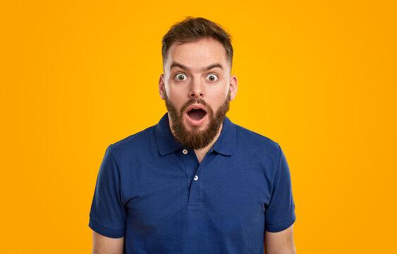 Amazed bearded man with mouth opened