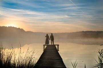 Couple on pier over Elizabeth's Lake