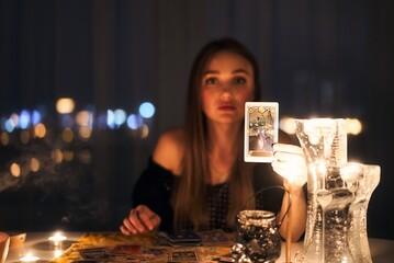 Obraz Woman reading tarot cards in spiritual room - fototapety do salonu