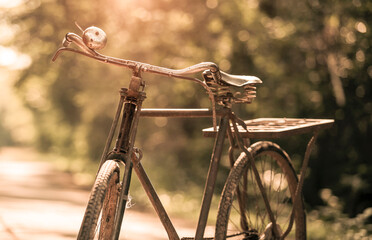 Old bicycle outdoors in blurred background, old bike in vintage style