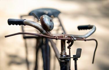 Vintage bicycle handlebar, old bicycle blur in background.