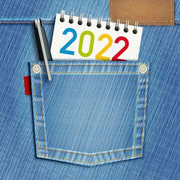 Concept de l'éducation scolaire et du cursus universitaire pour une carte de vœux 2022 avec une poche de blue-jeans et un bloc note comme symbole de la jeunesse.