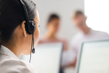 Diverse team of young professionals is working in the phone support office. Working day of sales managers in the call center. Business, telephone consulting and problem solving.